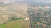 郊外の : Aerial view from airplane of outskirts and country villages - slow pan passing by camera wide shot