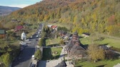 havai : Flying over carpathian city Yaremche and orthodox wooden church, Ukraine Stok Video