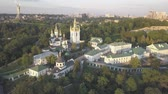 dnipro : Aerial panoramic view of Kiev Pechersk Lavra churches on hills from above, cityscape of Kyiv city Stock Footage