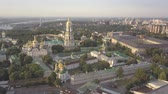 Киев : Aerial panoramic view of Kiev Pechersk Lavra churches on hills from above, cityscape of Kyiv city Стоковые видеозаписи