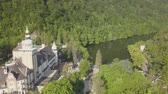 bastião : Aerial view to Lillafured Castle. Lillafured is one of the most beautiful natural environments, near Miskolc in the Eastern part of Bukk Mountains Stock Footage