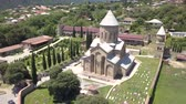 Aerial view to Transfiguration Church. The Pastor of the Thirteen Syrian Fathers. Mtskheta, Georgia Stock Footage