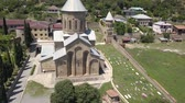 Aerial view to Transfiguration Church. The Pastor of the Thirteen Syrian Fathers. Mtskheta, Georgia Dostupné videozáznamy