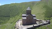 Aerial view of the Holy Trinity Church and the Holy Trinity Church, under Mount Kazbegi, Georgia Dostupné videozáznamy
