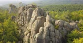 de faia : Aerial view to Dovbush Rocks in Bubnyshche at sunrise - a legendary place, the ancient cave monastery in fantastic boulders amidst beautiful scenic forests, popular with tourists and travelers in Eastern Europe and Ukraine Vídeos