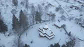 православный : Aerial view old wooden Orthodox church in mountain village Kryvorivnia, Ukrainian Carpathians. Calm cosy fairy-tale landscape. Typical landscape in Hutsulshchyna National Park.