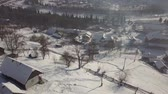 karpaten : Calm and cosy fairy-tale village Kryvorivnia covered with snow in the Carpathians mountains, aerial view