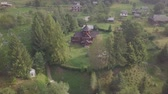 православный : Aerial to old wooden Orthodox church in mountain village Kryvorivnia in Ukrainian Carpathians mountains. Typical landscape in Hutsulshchyna National Park.