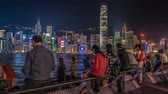 HONG KONGHONGKONG - NOV 11 2015: Time Lapse Peoples near Victoria Harbour Bay at Night, Hong Kong, Tsim Sha Tsui