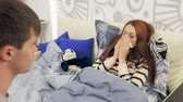 blow : Sick wife with fever with husband in bed taking care of her