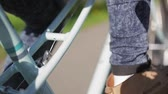fitness : Mans leg in jeans and boots on a bicycle focus in, in summer sunny day Stock Footage