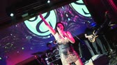 Lolita Milyavskaya perform on stage of nightclub. Raise one hand. Big screen Stok Video