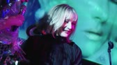 Lolita Milyavskaya and Tatiana Bulanova on stage of nightclub. Flowers. Screen Stok Video