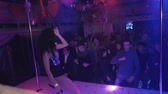 Back side MC girl in mouse ears, bodysuit, shake hair in nightclub. Slow motion Stok Video