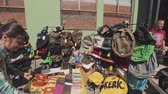 bugiganga : Young girl at counter in small street shop with leather backpacks, purse, bags, trinket. Summer sunny day. Shopping