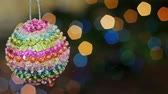 description : Christmas toy rotates at the background of blurred night lights. 2015 2016 new year.