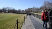 к северу : WASHINGTON DC -FEBRUARY 17: Names on Vietnam War Veterans Memorial on February 17, 2013 in Washington DC, USA. The memorial receives around 3 million visitors each year.