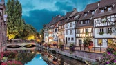 petite france : Colorful traditional french houses on the side of river in the evening in Colmar, France (static image with animated sky and water)