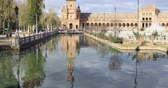 plaza de espana : Ascending view of northern tower reflecting in water on Plaza de Espana in Seville, Spain