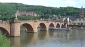 Heidelberg, Germany - May 14 2017: Tourist boat passes Old Bridge (Alte Brucke) across Neckar river