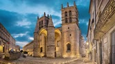 catholic : Gothic Cathedral of Saint Peter at dusk in Montpellier, Occitanie, France (static image with animated sky)