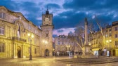 Town Hall square at dusk with clock tower and fountain in Aix-en-Provence, France (static image with animated sky)