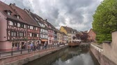 Colmar, France - May 13 2017: People walking on embankment in Petite Venise district - time lapse video