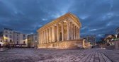 Maison Carree - restored roman temple in Nimes, France (static image with animated sky) Stok Video