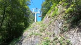 ormanlar : riding a chairlift up a mountain in the summer