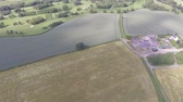 wales : Aerial footage over Welsh fields flying toward Hawarden golf club in Flintshire.