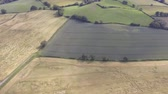 vidéki táj : Aerial footage over Welsh farm land in Hawarden North Wales. Stock mozgókép