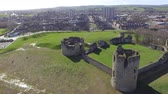 kastély : Aerial footage of Flint Castle on a bright spring day with Flint town in the background.