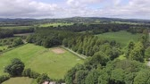 Aerial footage of Northop countryside at the start of summer with views over Clwydian hills.