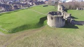 Aerial footage slowly flying towards Flint Castle. Stockvideo