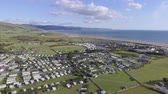 wales : This aerial shot is Talybont, Wales and looks out towards Barmouth. It shows a sunny day with caravans near the sea. You can also see the Welsh mountains in the distance.