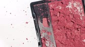 hasarlı : head view of makeup blush falling down and broked with pieces of powder get out