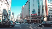 Япония : Tokyo, Japan - Jan 13, 2019: 4K UHD Motion timelapse of Ginza 4-Chome crossing, crowded people and transportation across junction. Ginza is Tokyo famous shopping area where car traffic close on Sunday Стоковые видеозаписи