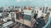 construcción de carreteras : Bangkok, Thailand - Sep 18, 2018: 4k UHD day to night holy grail time-lapse of building construction site in Bangkok city, end with traffic light trails and rain, aerial cityscape view Archivo de Video