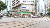 wan : Wan Chai, Hong Kong - July 4, 2019: 4K motion panning time-lapse of crowded people and car traffic transport across road intersection in Hong Kong. Commuter transportation, or Asian city life concept