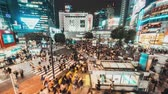 Япония : Tokyo, Japan - Nov 3, 2019: 4K Time-lapse of Shibuya scramble crossing, crowded people, car traffic transport at night, zoom out then still. Tokyo tourism, Japan transportation, Asia city life concept Стоковые видеозаписи