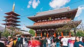 Япония : Tokyo, Japan - Nov 4, 2019: time-lapse of people walking in Senso-ji temple in Asakusa Tokyo, Japan. Japanese tourism landmark, Asia travel destination, or tourist attraction concept Стоковые видеозаписи