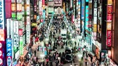 gastheer : Tokyo, Japan - Nov 2, 2019: time-lapse of crowd Asian people walk on Kabukicho street, Shinjuku red-light entertainment district. Tokyo nightlife tourist attraction, Japan travel destination. Zoom out