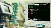 electrocardiograph : ICU monitor with hospital equipment in background