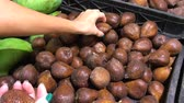 dessert : Snake fruit salak in supermarket. Woman selecting fresh organic exotic tropical fruits in the supermarket.