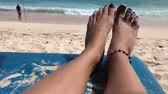 лежак : Woman feet on a beach chair on the paradise tropical beach of Bali island, Indonesia.