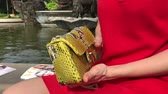 determinado : Woman with fashion luxury snakeskin handbag outdoors. Snakeskin python handbag.