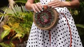 shoppingbag : Closeup of stylish rattand handbag in the tropical garden. Stock Footage