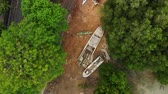 надувной : 4K aerial view of young couple in the old boat aground, tropical island of Bali, Indonesia.