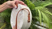 shoppingbag : Woman hands with stylich eco friendly rattan bag on a tropical background. Bali island.