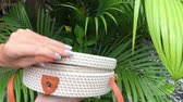 handbag : Closeup of stylish handmade rattan handbag on a tropical background. Bali island.